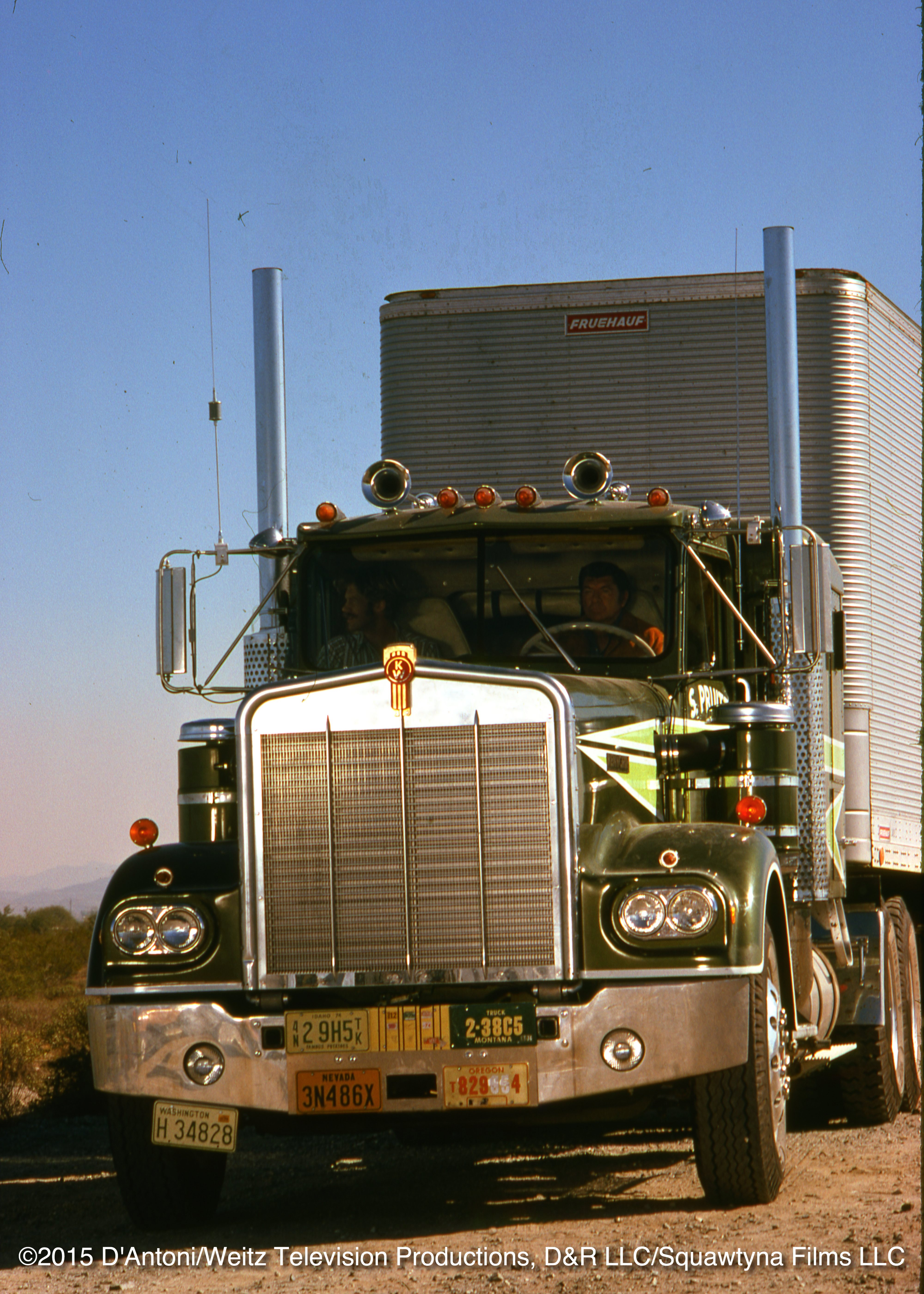 Head on view of Sonny driving the Big Green Kenworth. Will rides shotgun.