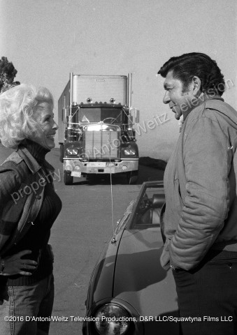 Claude Akins and Janet Leigh flirt
