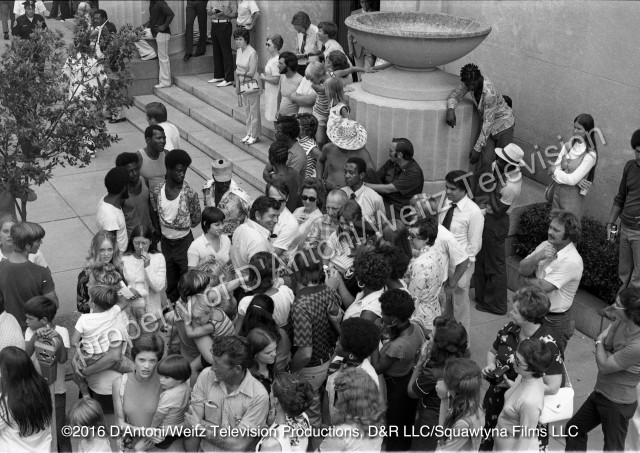 Claude Akins signs autographs for a crowd of fans