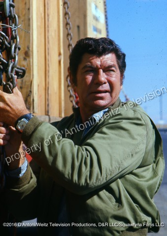 Claude Akins checks the load