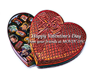 Heart-shaped box of Movin' On themed sweets.
