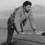 Claude Akins pushes broken down car
