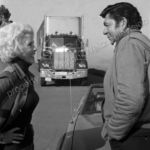 Claude Akins and Janet Leigh flirt