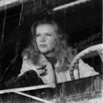 Anne Francis behind the windshield