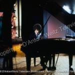 John Rubinstein plays piano