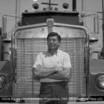 Claude Akins poses in front of In Tandem Kenworth