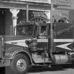 Claude Akins climbs out of Kenworth