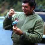 Claude Akins with mirror ornament